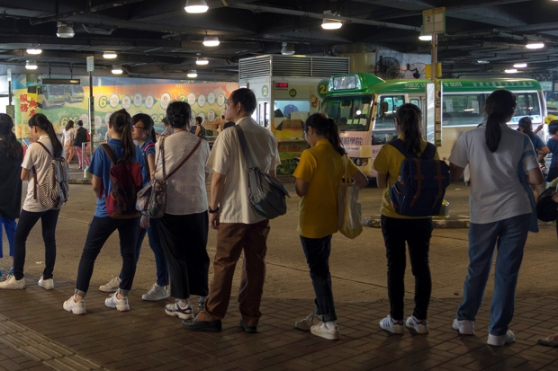 The queue for the green minibus grows longer in the Whampoa Gardens Bus Terminus. Buses are the main source of transportation in Whampoa. This particular bus goes to the Hung Hom Train Station, which is thirty minutes away by foot.