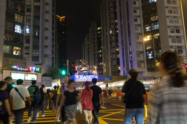 Even at night, the intersection of Hung Hom Road and Tak On Street is bustling with pedestrians.